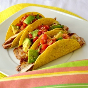 spicy bbq pork chop tacos with chunky avocado salsa